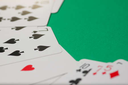 Classic playing cards on green background with place for text. Gambling and casino concept.