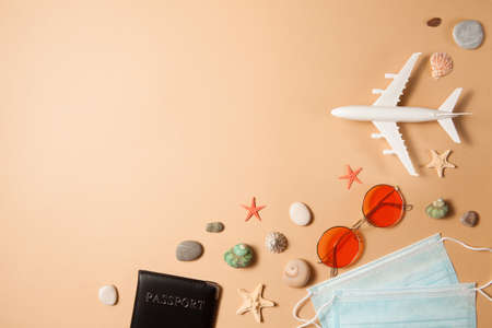 Optimistic  vacation concept. Summer 2021 vacation and travel background with sunglasses, medical mask, passport, airplane and travel symbols flat lay. Waiting spring or summer time.