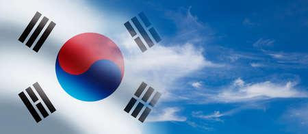 South Korea waving flag on the blue cloudy sky background.
