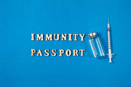 Immunity passport certificate  to stop lockdown, after vaccination or treatment against virus pandemy. Concept flat lay design for banner or blog.