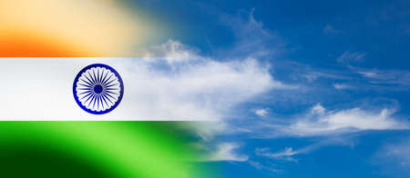 Indian flag waving on the blue cloudy sky background. India Independence day, 15 August.