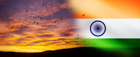 The wavy Indian flag on bright sky at sunset or sunrise background. Indian independence day, 15 August. Standard-Bild