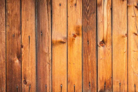 Wood texture. Wooden plank grain background. Striped timber desk closeup. Old table or floor. Brown boards.