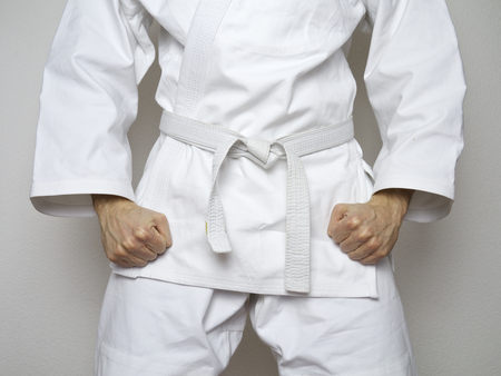 Fighter with white belt martial arts