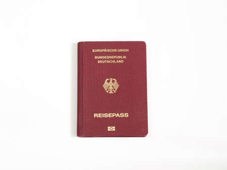 emigration and immigration: German passport isolated white background