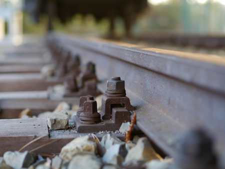 rustiness: German rail construction rusty screw and nut in Road Bed Horizon