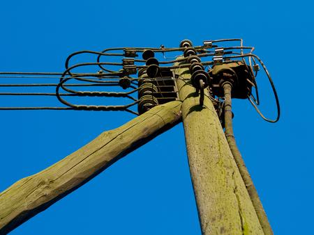 utility pole: Old power utility pole wood blue sky