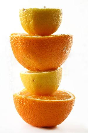 vitamines: Cut lemon and orange in layers on a white background