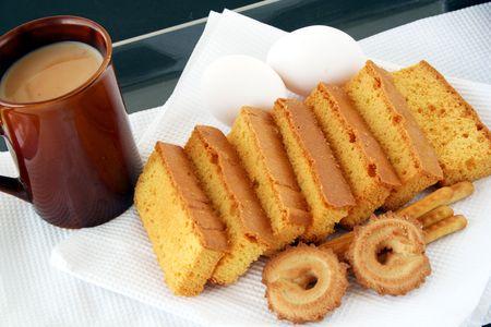 collation: rusk cake & biscuit & tea with milk mug