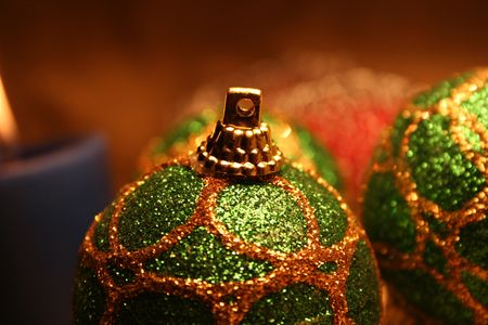 Christmas balls andamp,amp, candles on golden background 4 photo
