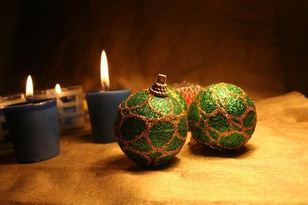 Christmas balls andamp,amp, candles on golden background 1 photo