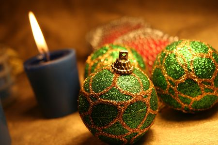 Christmas balls andamp,amp, candles on golden background 2 photo