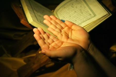 forgiveness: Worshiping hands pray and holy koran Stock Photo