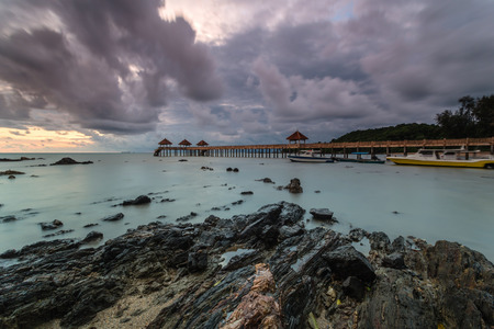 Long exposure Cloudy sunrise shot at jetty. Image contain certain grain or noise and soft focus when view at full resolution
