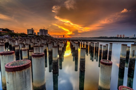 True tilt shift view of abandoned Concrit  poles from fencing in the sea ,waterfront City,Johor Bahru,Malaysia 写真素材
