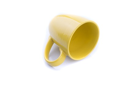 Yellow matt mug on a white background