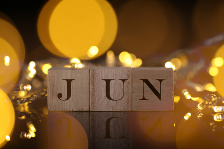 Month Concept, front view shows wooden block written Jun with light and bokeh background Banco de Imagens
