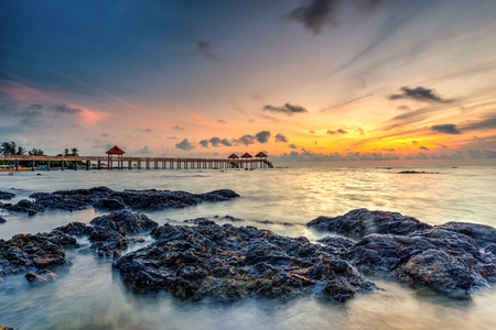 Beautiful long exposure sunrise shot at jetty. Image contain certain grain or noise and soft focus when view at full resolution Stock Photo