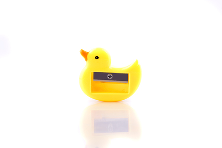 Yellow sharepner with duck shape isolated over white background