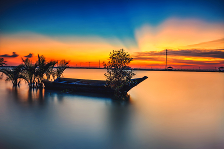 A scenic beauty of traditional fishing boat with sunset at Teluk Sengat,Johore, Malaysia with Soft focus due to long exposure.