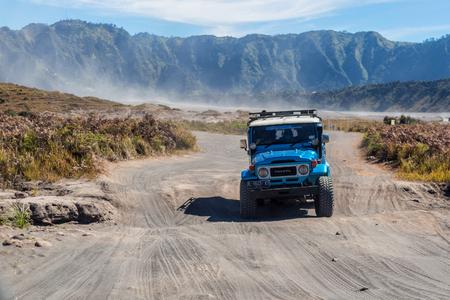 BROMO, INDONESIA - 9th May 2018; 4WD Jeep in Savana land in Bromo Tengger Semeru national park, East Java, Indonesia