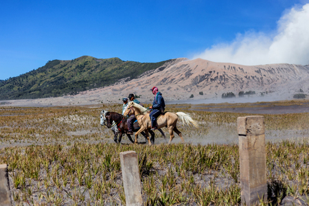 BROMO, INDONESIA - 9th May 2018; unidentified local people or Bromo Horseman pose for camera at the mountainside of Mount Bromo, Semeru, Tengger National Park, Indonesia