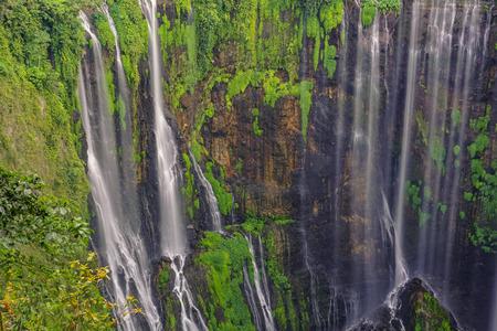 Beautiful Tumpak Sewu waterfall, Tumpak Sewu Waterfall or also called Coban Sewu is a 120 meter high waterfall located in Lumajang Regency, East Java. Tumpak Sewu Waterfall is the most beautiful waterfall on Java and Indonesia. Long Exposure. Standard-Bild - 123927193