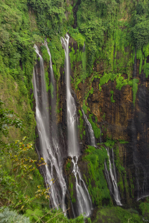 Beautiful Tumpak Sewu waterfall, Tumpak Sewu Waterfall or also called Coban Sewu is a 120 meter high waterfall located in Lumajang Regency, East Java. Tumpak Sewu Waterfall is the most beautiful waterfall on Java and Indonesia. Long Exposure. Standard-Bild - 123927242