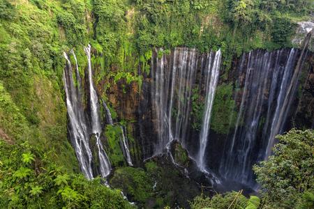 Beautiful Tumpak Sewu waterfall, Tumpak Sewu Waterfall or also called Coban Sewu is a 120 meter high waterfall located in Lumajang Regency, East Java. Tumpak Sewu Waterfall is the most beautiful waterfall on Java and Indonesia. Long Exposure. Standard-Bild - 123927252