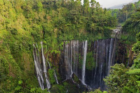 Beautiful Tumpak Sewu waterfall, Tumpak Sewu Waterfall or also called Coban Sewu is a 120 meter high waterfall located in Lumajang Regency, East Java. Tumpak Sewu Waterfall is the most beautiful waterfall on Java and Indonesia. Long Exposure. Standard-Bild - 123927257