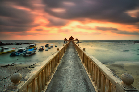 A long exposure of a stone jetty leading into the sea during monsun season, Tanjung Balau,Johore,Malaysia Standard-Bild - 121092351