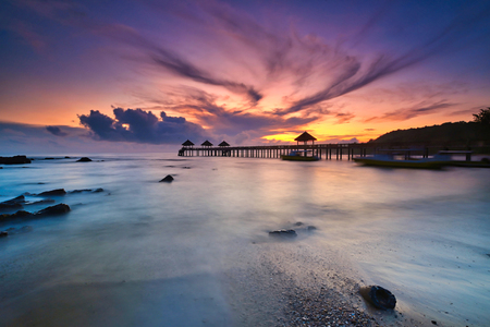 A long exposure of a stone jetty leading into the sea during monsun season, Tanjung Balau,Johore,Malaysia Standard-Bild - 121092352