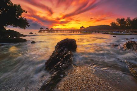 A long exposure of a stone jetty leading into the sea during monsun season, Tanjung Balau,Johore,Malaysia Standard-Bild - 121092355