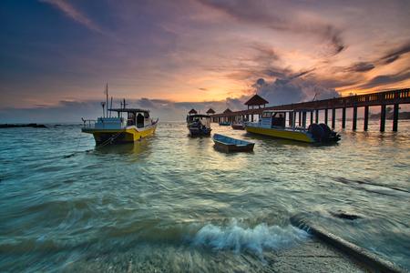 A long exposure of a stone jetty leading into the sea during monsun season, Tanjung Balau,Johore,Malaysia Standard-Bild - 121092357