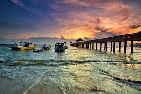 A long exposure of a stone jetty leading into the sea during monsun season, Tanjung Balau,Johore,Malaysia Standard-Bild - 121092359