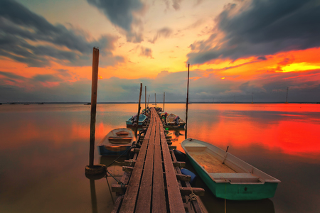 A scenic beauty of traditional fishing boat with sunset at Teluk Sengat,Johore, Malaysia with Soft focus due to long exposure Standard-Bild - 121092366