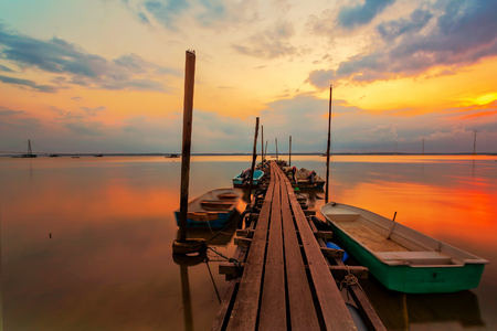 A scenic beauty of traditional fishing boat with sunset at Teluk Sengat,Johore, Malaysia with Soft focus due to long exposure Standard-Bild - 121092363