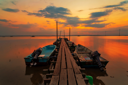 A scenic beauty of traditional fishing boat with sunset at Teluk Sengat,Johore, Malaysia with Soft focus due to long exposure Standard-Bild - 121092368