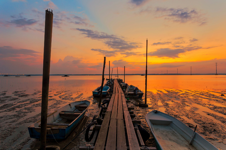 A scenic beauty of traditional fishing boat with sunset at Teluk Sengat,Johore, Malaysia with Soft focus due to long exposure Standard-Bild - 121092371