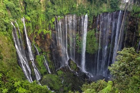 Beautiful Tumpak Sewu waterfall, Tumpak Sewu Waterfall or also called Coban Sewu is a 120 meter high waterfall located in Lumajang Regency, East Java. Tumpak Sewu Waterfall is the most beautiful waterfall on Java and Indonesia. Long Exposure. Standard-Bild - 123018706
