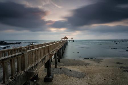 A beautiful long exposure sunrise at the jetty Standard-Bild - 121092465