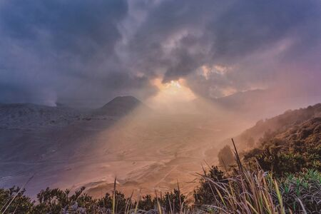 A dramatic fogging cloudy Sunset at Mount Bromo, is an active volcano and part of the Tengger massif, in East Java, Indonesia