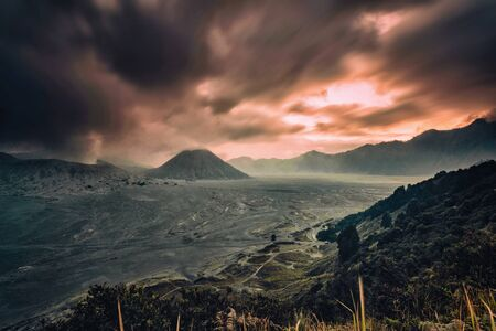 A Dramatic cloudy Sunset at  Mount Bromo, is an active volcano and part of the Tengger massif, in East Java, Indonesia