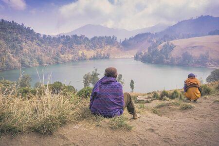 An  unidentified local people or Bromo Horseman looking away at mountain in Semeru Mountain, Indonesia