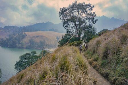 A Hiker is walking at the trail going to  mountain at Semeru Mountan, Indonesia Фото со стока
