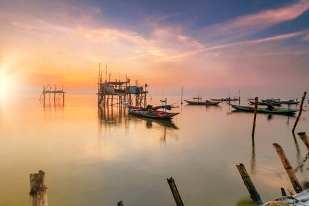 Beautiful view on sunrise with wooden boat as a subject at Kenjeran beach,Surabaya.Indonesia Stok Fotoğraf