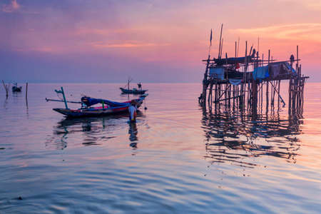 Beautiful view on sunrise with wooden boat as a subject at Kenjeran beach,Surabaya.Indonesia Editöryel