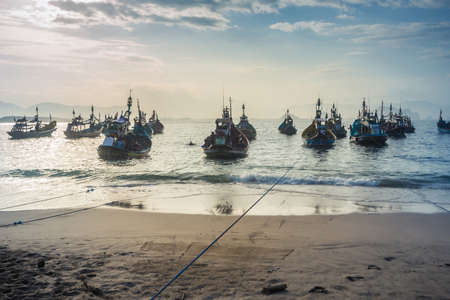 Jember, East Java / Indonesia - May 12  2018: Fishermen return to shore with their catch at Tanjung Papuma beach, Jember, East Java