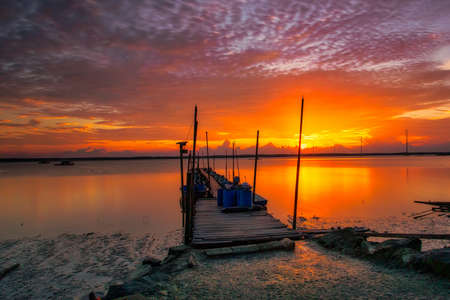 Golden orange sunset over the jetty at Kota Tinggi, Johore
