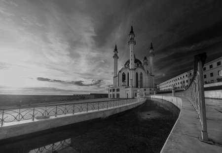 Black and white photo with textured clouds in Tatarstan, Kazan Kremlin, panorama of the Kul-Sharif mosque against the background of sunset.